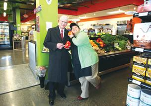 Developer Dwight Unti, left, with Lillian Negran, added a boutique grocery store to his apartment complex.