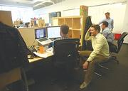 Employees collaborate in the open offices of Jama Software's Pearl District headquarters.