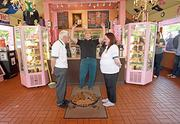 "Voodoo Doughnut co-owner Kenneth ""Cat Daddy"" Pogson officiates the wedding of Gordon and Karen Gregor at the Voodoo store at 1501 N.E. Davis St. The couple from England heard about Voodoo-hosted weddings on the Travel Channel in 2006 and made the decision to get married there."