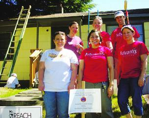 Advantis employees helped paint a North Portland house at the annual Reach Paint & Repair-a-thon.
