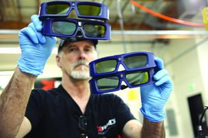 XPAND employee George Yocum tests the range of 3D glasses at the Beaverton facility, which is where the Slovenia-based company's production team is based.