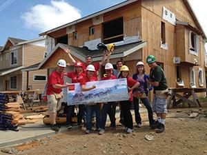Wells Fargo team members volunteered Aug. 3 for Habitat for Humanity to build an affordable home in Portland.