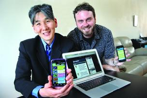 Russell Okamoto, left, and Greg Passmore tested their startup's product via the Occupy Portland movement.