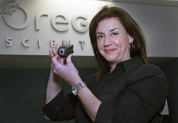 Oregon Scientific Marketing Director Jennifer Harmon — holding a Chameleon camera the company recently introduced — wants to reach a broader audience.