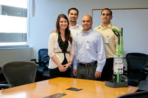 The PoogoStick, invented by Jordan Buhagiar and members of his Sacramento-area family, is designed to speed cleanup of pet waste. It goes on sale at PetSmart stores next year. Pictured above, from left, are Jenna, Josh, Jordan and Jason Buhagiar.