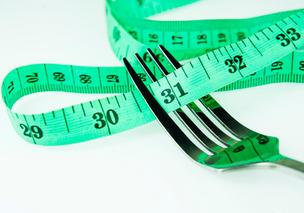 measuring tape fork dieting weight loss