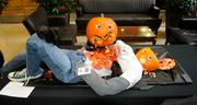 """Most Scary--""""Zombie Pumpkin,"""" a truly stunning display of a disemboweled scarecrow complete with two humans portraying horrifying zombies — complete with insects (the gummy variety) coming out of their mouths. It was the work of employees in Business Management Bureau of the state Department of Insurance, 300 Capitol Mall. (The same office won """"most creative"""" last year.) Best detail on this one: The corpse had a Department of Insurance ID badge, complete with a photo of a screaming man."""