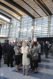 People gather inside the airport terminal before the Business Journal's Structures panel.