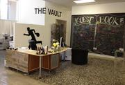 A vault turned kitchen at 3fold Communications features beer on tap, as well as the office resident thief, Robin de Vault, depicted in black vinyl. The chalkboard wall supports brainstorming sessions.