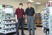Ryan Tollefson and his father Don Tollefson, at the new Batteries Plus location in West Sacramento. The son and his wife are active in the family's business and are becoming part owners.