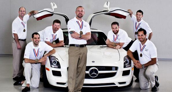 Mechanic Scott Baylis of Mercedes-Benz of Sacramento leans on a car door on the left, along with Ralph Johonnot of Mercedes-Benz of Rocklin, who is leaning on a car door on the right. The mechanics were part of an American team that beat out other Mercedes teams in an international technicians competition.