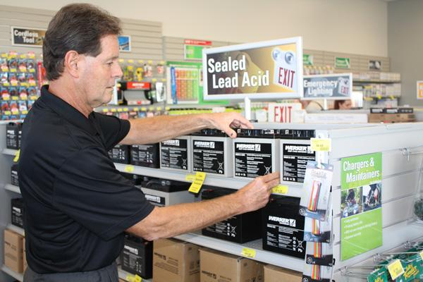 Batteries Plus franchisee Don Tollefson looks at stock of lead acid car batteries at his new West Sacramento location. It's his fourth store, and he's looking to add more.
