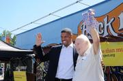 Tower Records founder Russ Solomon nabs Mayor Kevin Johnson's tie. Solomon was notorious for removing ties worn by visitors to Tower Records' offices. Contrary to legend, he didn't necessarily cut them in half. Confiscating them was just as effective.