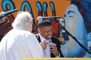 Tower Records founder Russ Solomon confiscates Mayor Kevin Johnson's tie. Solomon was notorious for removing ties worn by visitors to Tower Records' offices. Contrary to legend, he didn't necessarily cut them in half. Confiscating them was just as effective.