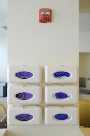 Boxes of new gloves are ready at the infusion area at the cancer center expansion.