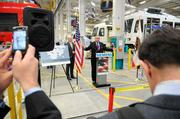 U.S. Secretary of Transportation Ray LaHood answers questions from the media. I usually try to include the media with a subject. It seems to tell a story, instead of a person just talking.  From the story: Transportation Secretary LaHood tours Siemens light-rail facility