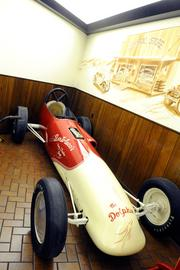 """This vintage dragster, """"The Dolphin,"""" was constructed in 1945, but it's based on a 1928 Chevrolet frame. Everything else was fabricated for $900. Powered by a 321 cubic-inch engine, it clocked 175 mph at Bonneville and 130 mph at Kingdon Drag Strip in Lodi."""