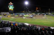 Audience members watch as Raley Field is taken over by seven monster trucks.