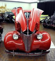 This 1939 Chevrolet coupe street and drag rod is decked out in Ferrari red. It has a 292 cubic-inch engine that produces 300 horsepower. It can do 103 mph on the quarter-mile on street tires.