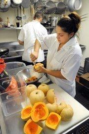 Karely Farrera prepares butternut squash for roasting at Sacramento's Biba Restaurant.