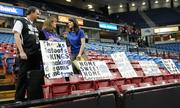 Just as a tentative arena deal had been announced, my assignment was to photograph fans with signs, team owners the Maloofs and Mayor Kevin Johnson at a Feb. 28 game between the Sacramento Kings and the Utah Jazz. Before the game, I found Nick and Barb Rust with a row of homemade signs Barb Rust made. They were preparing for a live shot with KXTV-TV Channel 10 reporter Kristen Drew.   For the story: Big arena deal also a big challenge
