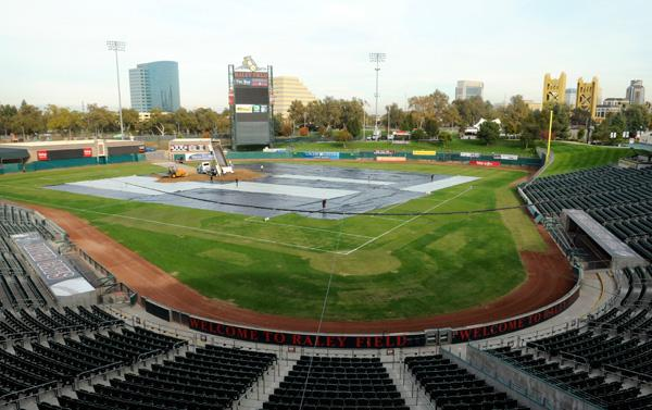 Plastic protects the grass at Raley Field as the first bit of dirt is spread out in preparation for a monster truck rally.