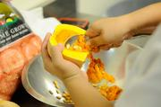 In the kitchen at Biba Restaurant, Karely Farrera prepares butternut squash to be used in soup.