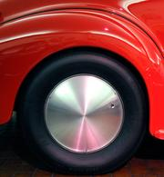 This 1939 Chevrolet coupe street and drag rod is decked out in Ferrari red and custom hubcaps.