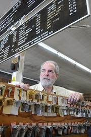 Rick Vanina of J & J Locksmiths paid a local attorney $5,000 to settle what could have been a lengthy disability access lawsuit over the parking lot of his Fulton Avenue shop. Legal requirements on businesses affect employers of all sizes, but they hit small employers especially hard because there's generally less margin for error.    I positioned Vanina between a row of keys and his list of prices. I liked the angle of the two boards, so I got down low and shot up at Vanina to to include both angles. The image was more interesting with him looking away from the camera, rather than straight at me.   From the story: Trio of new laws may boost small business