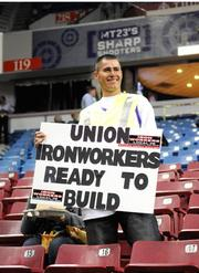 Just as a tentative arena deal had been announced, my assignment was to photograph fans with signs, team owners the Maloofs and Mayor Kevin Johnson at a Feb. 28 game between the Sacramento Kings and the Utah Jazz. James Vargas brought a sign showing his eagerness to get started on a new downtown arena.  For the story: Big arena deal also a big challenge