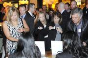 People get ready to enter the 40 Under 40 awards party at Cafeteria 15L.