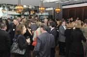 A crowd mingles while waiting for the 40 Under 40 awards to begin Thursday night at Cafeteria 15L.