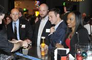 People at the 40 Under 40 awards get drinks while waiting for the main action to start Thursday evening.