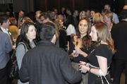 A crowd mingles while waiting for the 40 Under 40 awards to begin Thursday evening.