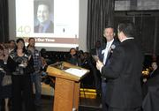 A 40 Under 40 winner accepts his award. Winners shared a few words of thanks or fun little quips.