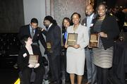 40 Under 40 awards winners line up with their awards.