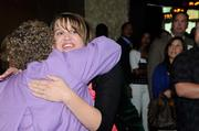 A 40 Under 40 winner gets a hug from Sacramento Business Journal Publisher Joanna Wessman.