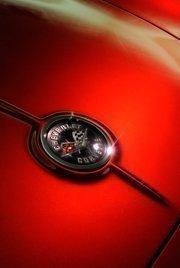 Detail of an emblem on Beverly Bertolucci's 1962 Chevrolet Corvette.