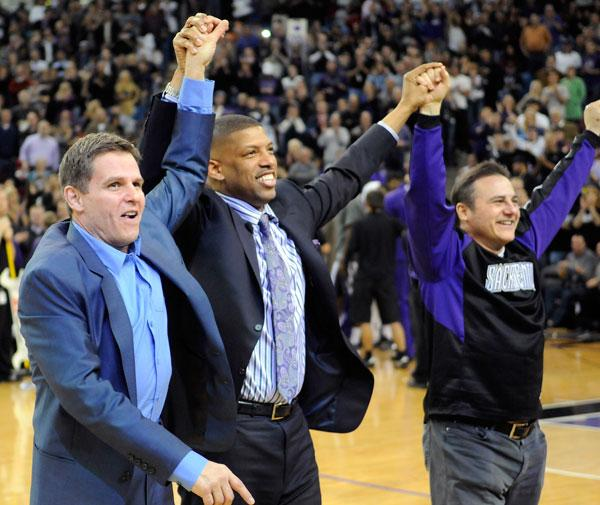 Joe Maloof, left, Sacramento Mayor Kevin Johnson and Gavin Maloof take the floor during a Feb. 28 Kings game. Some community and business leaders are asking the National Basketball Association to force the Maloof family to give up ownership of the Sacramento Kings, in wake of a souring arena deal.