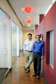Scott & Baldwin CPAs moved from a 7,000-square-foot office it leased in Roseville to buy an office the exact same size -- which came with a mortgage less than half the cost of its rent.   The red wall in the hallway of the office really caught my attention, and then I noticed the red lights in the ceiling. I just had to use the red. With natural light coming through the windows on the left, it was the perfect place to photograph the firm's partners, Mark Scott and Steven McCormick.From the story: SBA loans big for buildings