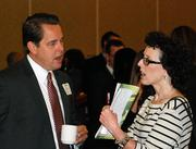 Five Sacramento-area finance executives won honors Friday at the Sacramento Business Journal's fifth annual CFO of the Year awards breakfast.Kurt Hoffman, AON Risk Services talks with Business Journal staff writer Kelly Johnson.