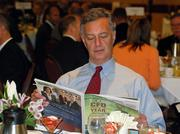 Ross Financial's Peter Ross reads the Sacramento Business Journal's CFO of the Year publication.