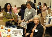 Women Who Mean Business honoree Jenine Windeshausen, left, with her sister, Alexis Lorenz, and mother, Helen Robles.