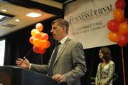 """Jeff Flint, a partner at FSB Core Strategies, accepts an award at Tuesday's """"A-plus Employers"""" event, which celebrated the best places to work in the Sacramento region."""