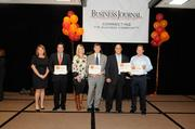 """Representatives of companies winning awards at the Sacramento Business Journal's annual """"A-plus Employers"""" event for local companies selected as the best places to work."""