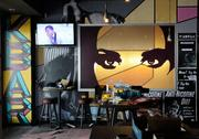 Art by Shaun Burner, a local artist, is featured prominently in KBAR.