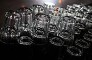 Glasses are lined up on the bar.