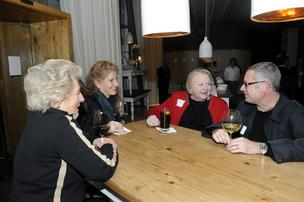 People chat at the Book of Lists party at Ella Dining Room & Bar.