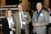 Business leaders and members of the community gathered for networking and good food at the Business Journal's Book of Lists party Monday night. At center is Edward Johnson of Warren G. Bender Co.