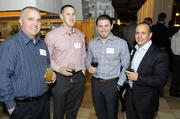 Business leaders and members of the community gathered for networking and good food at the Business Journal's Book of Lists party Monday night. Two men at center are Shaun Leeper and Brandon Brodsky of Invision BC&R.